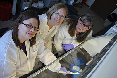 Kerri Basten (left), clinical lab analyst, with externs Heather Davidson and Lisa Skilang