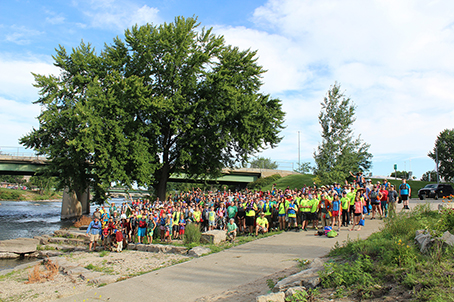 A group of AWARE volunteers gather on the banks of the upper Cedar River.
