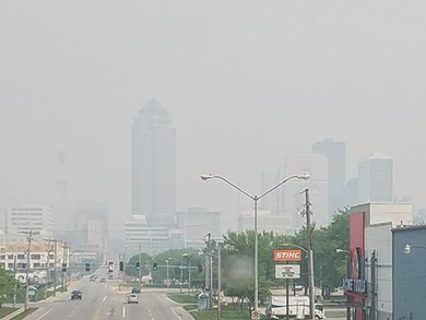 "A thick blanket of smoke from wildfires that originated in Canada hovers over Des Moines on May 7, and causes the EPA to issue an ""Unhealthy for Sensitive Groups"" alert."